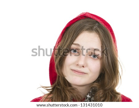Pre teen young girl with serious expression on white background - stock photo