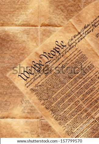 preamble to the constitution of the united states of america. The background is the second page turned over so the words can be seen through.  - stock photo