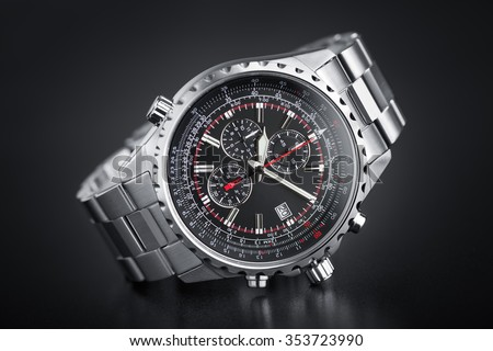 Precious chronograph watch in stainless steel in black circular gradient background - Logos, brand, or anything has been deleted to be hundred percent commercial. - stock photo