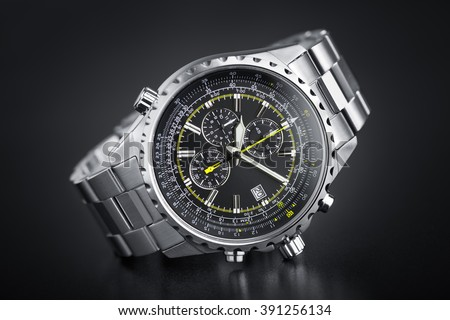 Precious chronograph watch in stainless steel in black circular gradient background - Logos, brand, or anything has been deleted to be 100% commercial. - stock photo