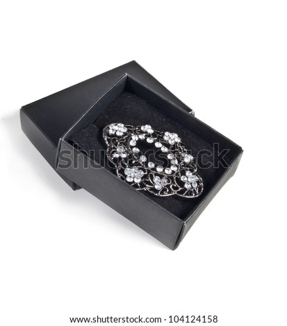 Precious jewellery brooch in black box, isolated on white background - stock photo