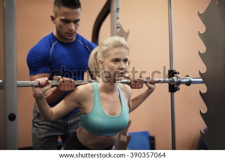 Precise workout with personal trainer - stock photo