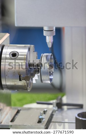 precision automatic marking machine with chuck and C-Axis - stock photo