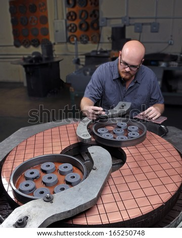 Precision Machinist at work in a Machine Shop - stock photo
