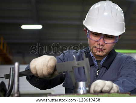 Precision measurement tools in a mechanics plant - stock photo