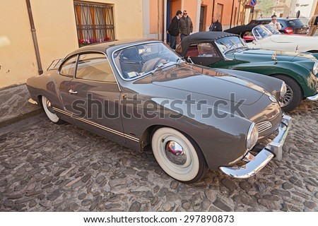 "PREDAPPIO ALTA, FC, ITALY - APRIL 12: vintage German car Volkswagen Karmann Ghia Type 14 (1963) in classic car rally ""Passeggiata turistica primaverile"" on April 12, 2015 in Predappio Alta, FC, Italy"