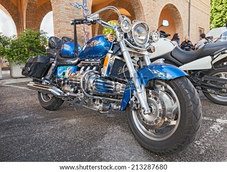 "PREDAPPIO (FC) ITALY - MAY 12: custom motorbike six cylinder engine Honda Valkyrie GL1500C F6C parked during the motorcycle rally ""Mototagliatella 2013"" on May 12, 2013 in Predappio (FC) Italy  - stock photo"