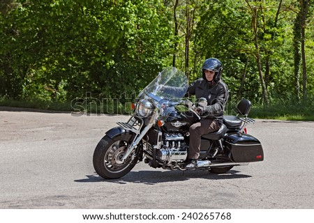 "PREDAPPIO, ITALY - MAY 12: biker riding a big motorbike six cylinder engine Honda GL1500C F6C at motorcycle rally ""Mototagliatella 2013"" on May 12, 2013 in Predappio (FC) Italy - stock photo"