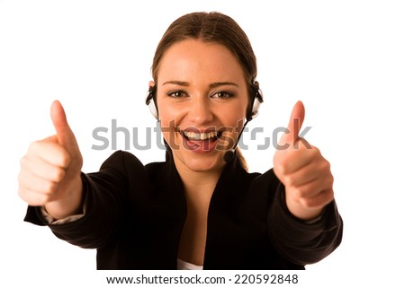 Preety happy asian caucasian business woman with headset showing thumb up as a gesture for success isolated - stock photo