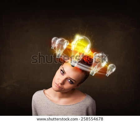 Preety woman with light bulbs circleing around her head  - stock photo