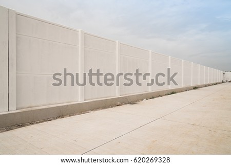 Prefabricated concrete fence isolated on sky background.