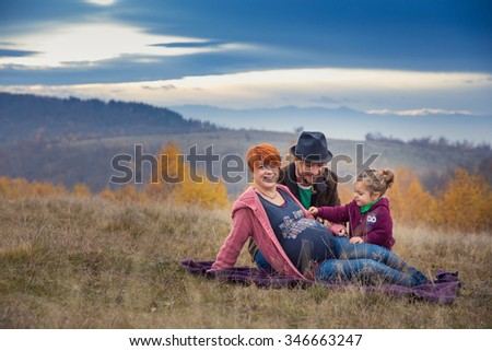 Pregnancy, maternity and family picture in outdoors