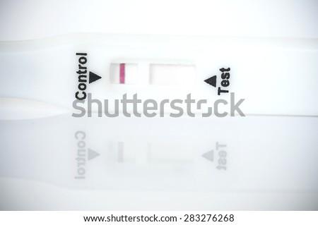 Pregnancy tester closedup on white background - stock photo