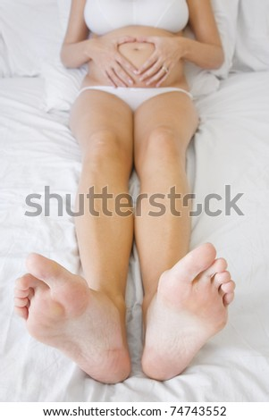 Pregnancy woman from the toes up - stock photo