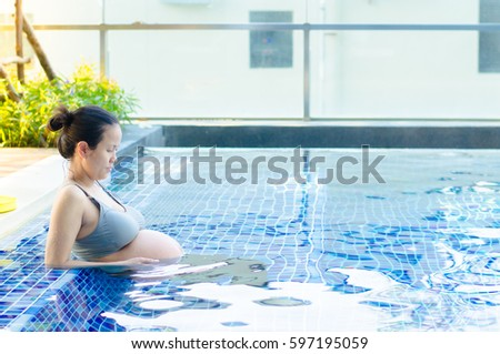 Pregnant Asia Woman On Swimming Pool Background, Healthy Concept.