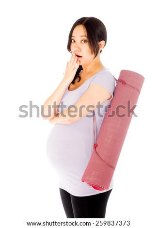 Pregnant asian woman isolated on white mistake