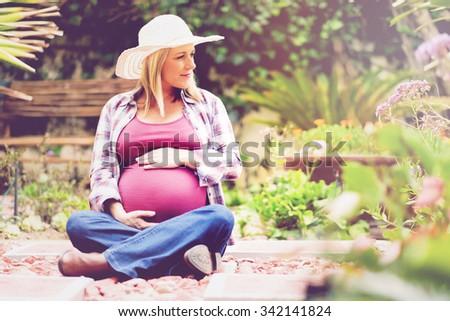 Pregnant Beautiful Blonde Lady - stock photo