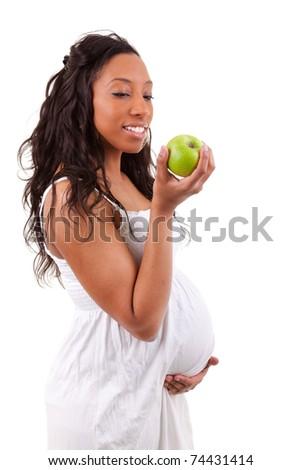 pregnant black woman eating an apple - stock photo