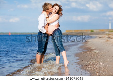 Pregnant family near the sea