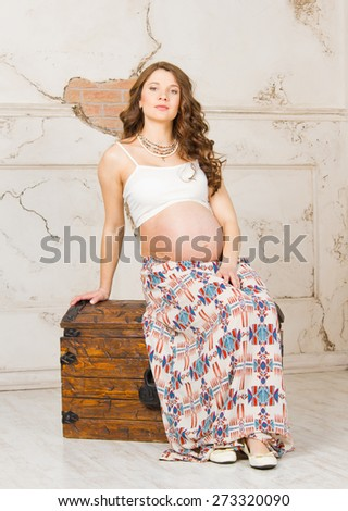 Pregnant model in studio - stock photo