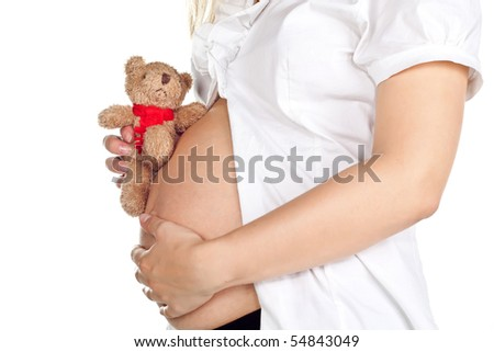 Pregnant pretty woman in studio over white background - stock photo
