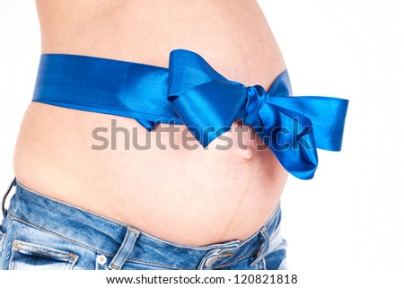 Pregnant tummy with a blue satiny bow