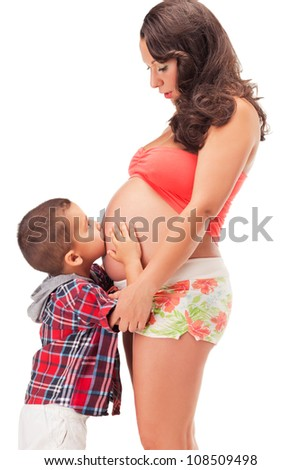 Pregnant woman and a little boy - stock photo
