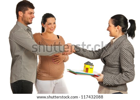 Pregnant woman and her husband  buying new house and shaking hand with real estate agent woman isolated on white background - stock photo
