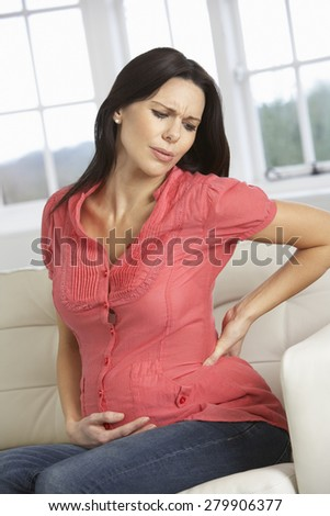 Pregnant Woman At Home With Backache