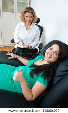 pregnant woman at prenatal psychological therapy with her therapist - stock photo