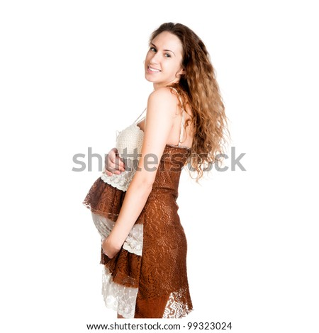 pregnant woman caressing her belly over white background - stock photo