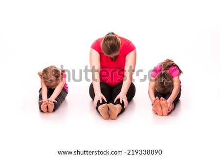 Pregnant woman doing gymnastic exercises with kids isolated over white background, active and sportive pregnancy, healthy motherhood concept