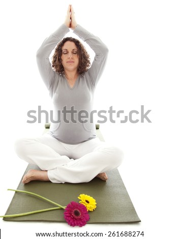 Pregnant woman doing yoga - stock photo