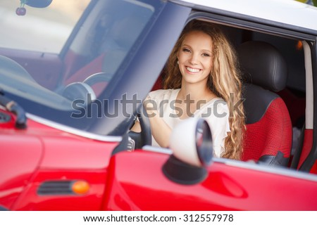 Pregnant Woman Driving a Car. pregnant woman in driving seat of the car. portrait of young beautiful pregnant woman outdoors. smiling pregnant woman sitting in car - stock photo