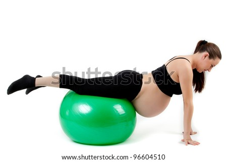 Pregnant woman excercises with gymnastic ball. - stock photo