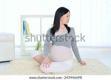 Pregnant woman exercise - stock photo