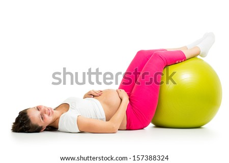 Pregnant woman exercises with gymnastic fit ball - stock photo