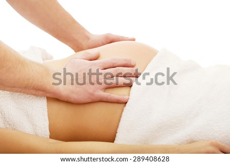 Pregnant woman having a massage on her belly - stock photo