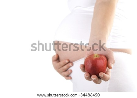 Pregnant woman holding apple. Nine month. Third trimester