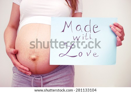 pregnant woman holding banner - stock photo