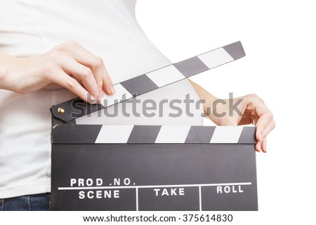 Pregnant woman holding movie clapperboard isolated on white - stock photo
