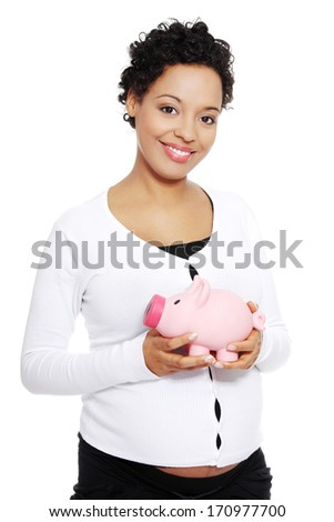 Pregnant woman holding piggy bank , isolated on white background