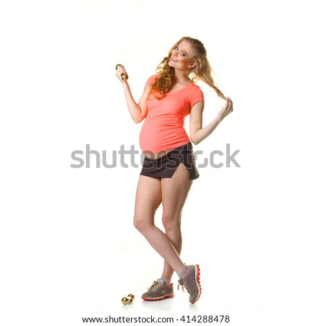 Pregnant woman in for sports. Pregnant woman doing exercise with dumbbells. Pregnant woman exercising with training weights - stock photo