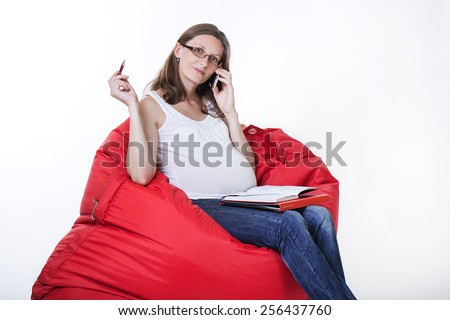 Pregnant woman in home office  on white background - stock photo