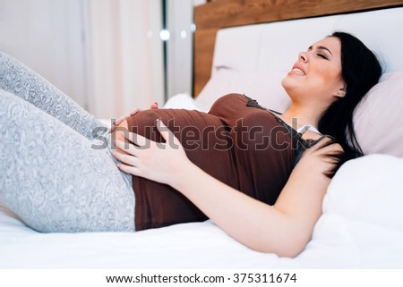 Pregnant woman in pain having cramps