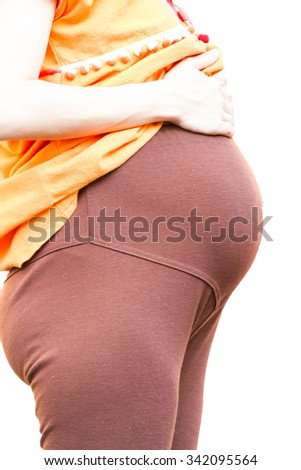Pregnant woman isolated on white background - stock photo