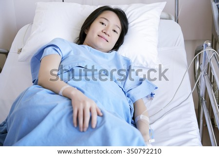 Pregnant woman lying in maternity hospital before childbirth. - stock photo