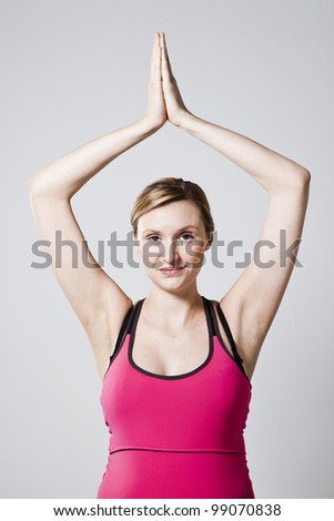 Pregnant woman meditating with hands together. Studio shot - stock photo