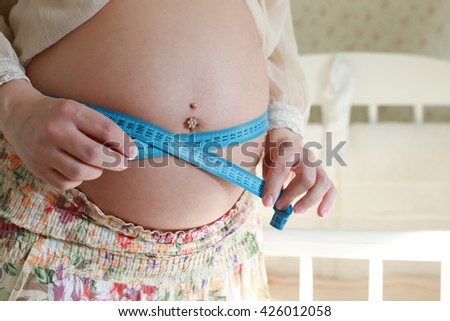 pregnant woman mesaurment belly