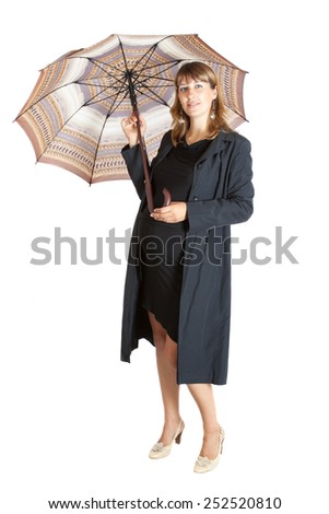 pregnant woman (9 months) with a open umbrella, isolated on white - stock photo